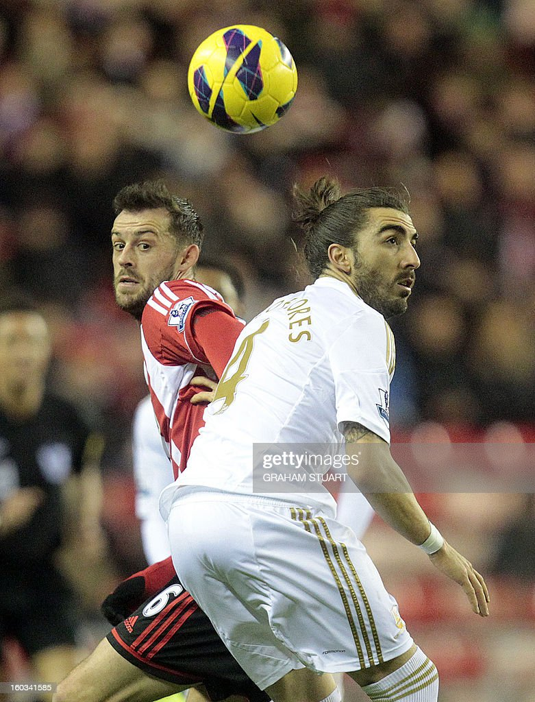 "Sunderland's English-born Scottish striker Steven Fletcher (L) vies with Swansea City's Spanish defender Chico Flores (R) during the English Premier League football match between Sunderland and Swansea City at The Stadium of Light in Sunderland, north-east England on January 29, 2013. USE. No use with unauthorized audio, video, data, fixture lists, club/league logos or ""live"" services. Online in-match use limited to 45 images, no video emulation. No use in betting, games or single club/league/player publications"