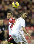 Sunderland's Englishborn Scottish striker Steven Fletcher vies with Swansea City's Spanish defender Chico Flores during the English Premier League...