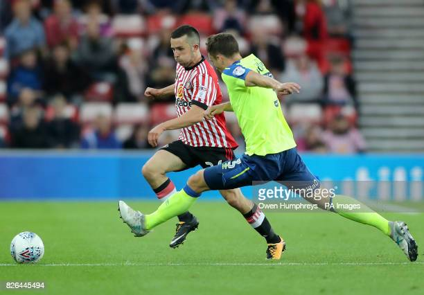Sunderland's Ethan Robson and Derby County's Craig Forsyth battle for the ball during the Sky Bet Championship match at the Stadium of Light