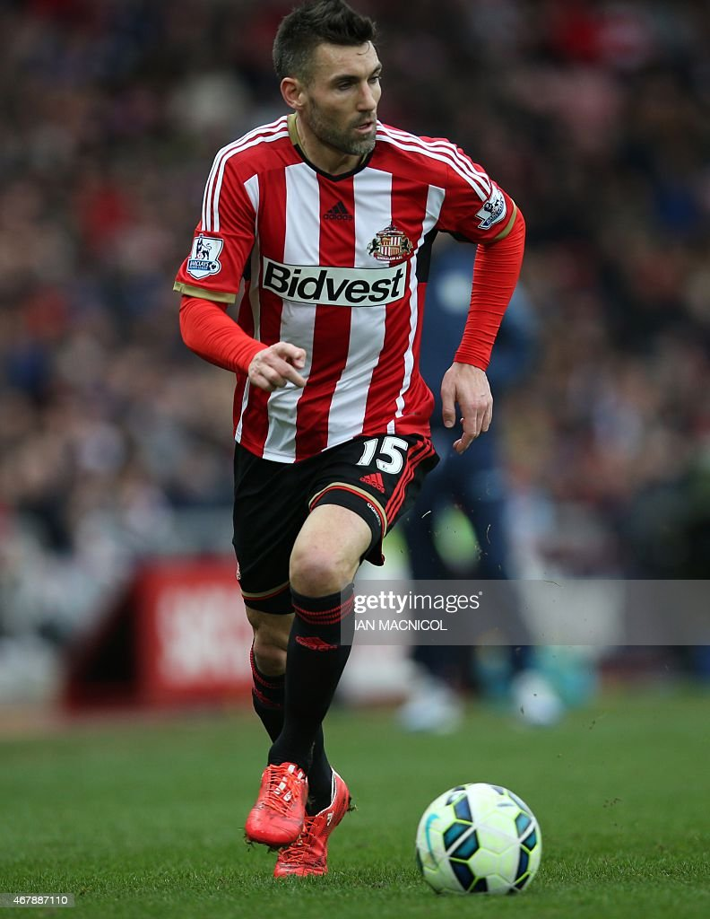 Sunderland's French defender <a gi-track='captionPersonalityLinkClicked' href=/galleries/search?phrase=Anthony+Reveillere&family=editorial&specificpeople=221020 ng-click='$event.stopPropagation()'>Anthony Reveillere</a> runs with the ball during the English Premier League football match between Sunderland and Aston Villa at the Stadium of Light in Sunderland, northeast England on March 14, 2015. Aston Villa won the match 0-4.