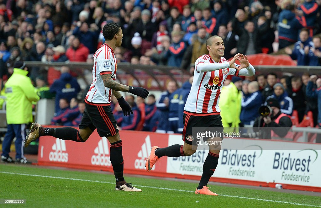 Sunderland's French-born Tunisian midfielder Wahbi Khazri (R) celebrates scoring his team's first goal during the English Premier League football match between Sunderland and Manchester United at the Stadium of Light in Sunderland, northeast England on February 13, 2016. / AFP / OLI SCARFF / RESTRICTED TO EDITORIAL USE. No use with unauthorized audio, video, data, fixture lists, club/league logos or 'live' services. Online in-match use limited to 75 images, no video emulation. No use in betting, games or single club/league/player publications. /