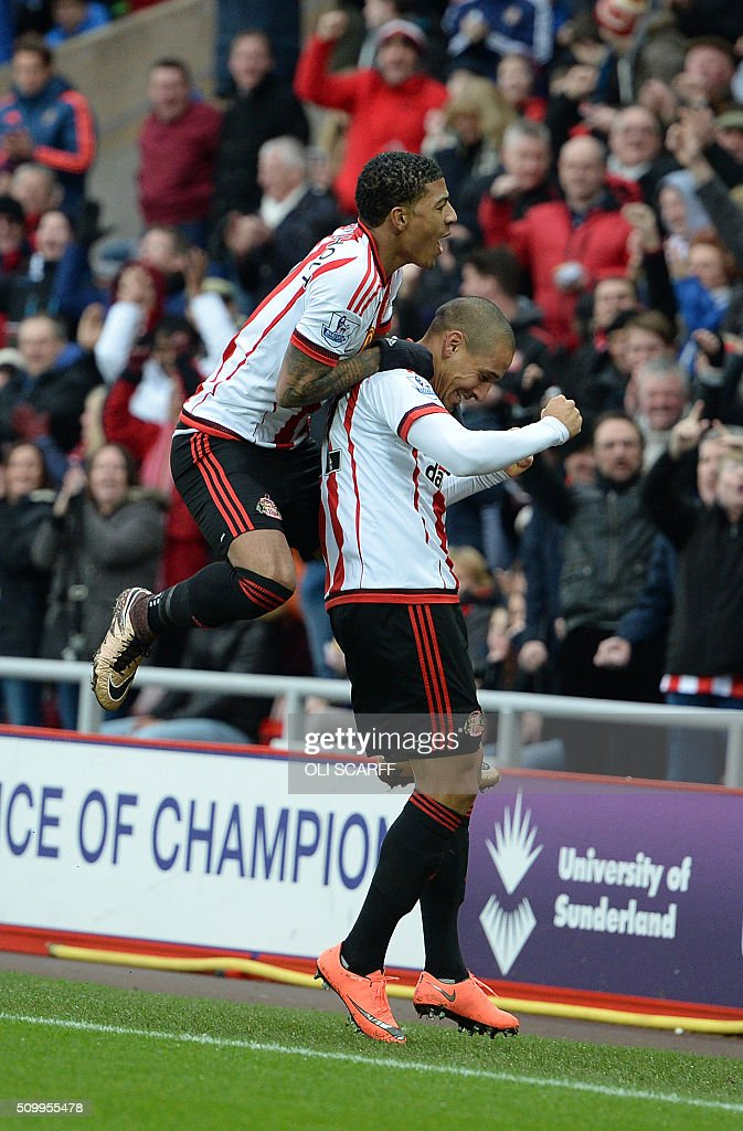 Sunderland's French-born Tunisian midfielder Wahbi Khazri (R) celebrates scoring his team's first goal with Sunderland's Dutch defender Patrick van Aanholt during the English Premier League football match between Sunderland and Manchester United at the Stadium of Light in Sunderland, northeast England on February 13, 2016. / AFP / OLI SCARFF / RESTRICTED TO EDITORIAL USE. No use with unauthorized audio, video, data, fixture lists, club/league logos or 'live' services. Online in-match use limited to 75 images, no video emulation. No use in betting, games or single club/league/player publications. /