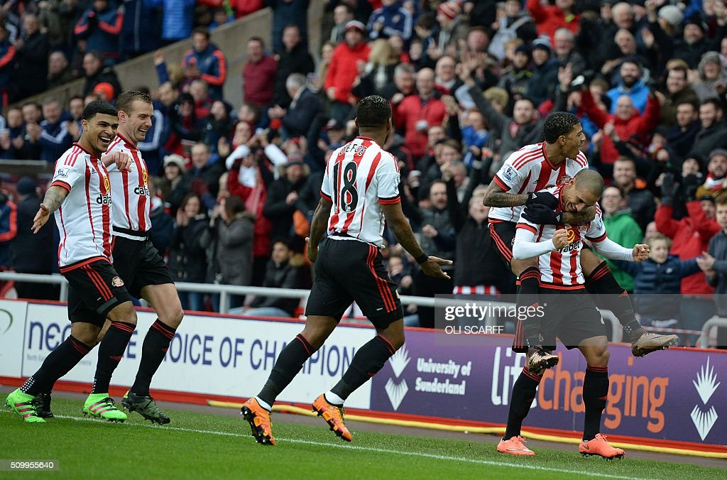 Sunderland's French-born Tunisian midfielder Wahbi Khazri (R) celebrates scoring his team's first goal with teammates during the English Premier League football match between Sunderland and Manchester United at the Stadium of Light in Sunderland, northeast England on February 13, 2016. / AFP / OLI SCARFF / RESTRICTED TO EDITORIAL USE. No use with unauthorized audio, video, data, fixture lists, club/league logos or 'live' services. Online in-match use limited to 75 images, no video emulation. No use in betting, games or single club/league/player publications. /