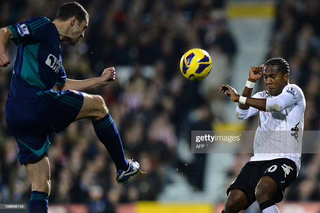 """Sunderland's Irish defender John O'Shea (L) vies for the ball with Fulham's Colombian striker Hugo Rodallega (R) during the English Premier League football match between Fulham and Sunderland at Craven Cottage in London on November 18, 2012. USE. No use with unauthorized audio, video, data, fixture lists, club/league logos or """"live"""" services. Online in-match use limited to 45 images, no video emulation. No use in betting, games or single club/league/player publications."""
