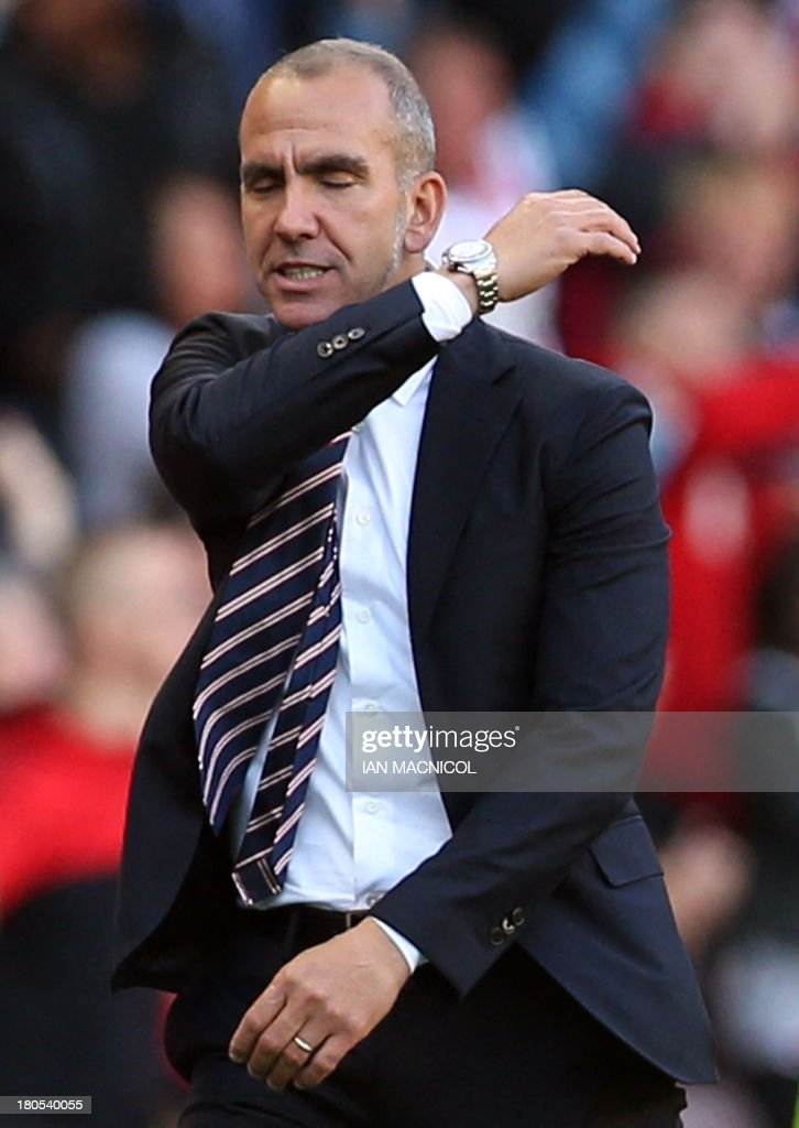 Sunderland's Italian manager Paolo Di Canio gestures during the English Premier League football match between Sunderland and Arsenal at the Stadium of Light in Sunderland, northeast England, on September 14, 2013. AFP PHOTO / IAN MACNICOL USE. No use with unauthorized audio, video, data, fixture lists, club/league logos or live services. Online in-match use limited to 45 images, no video emulation. No use in betting, games or single club/league/player publications.