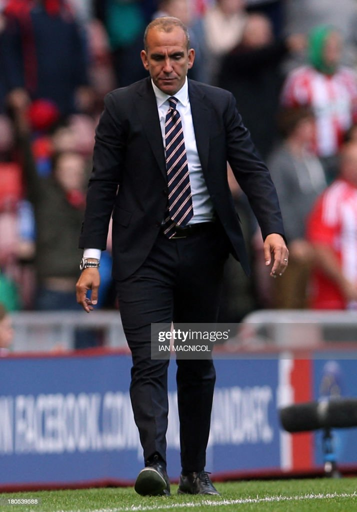 Sunderland's Italian manager Paolo Di Canio walks on the touchline during the English Premier League football match between Sunderland and Arsenal at the Stadium of Light in Sunderland, northeast England, on September 14, 2013. USE. No use with unauthorized audio, video, data, fixture lists, club/league logos or live services. Online in-match use limited to 45 images, no video emulation. No use in betting, games or single club/league/player publications.