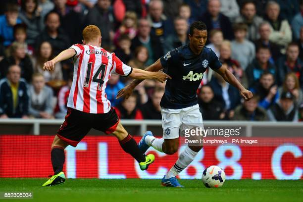 Sunderland's Jack Colback and Manchester United's Luis Nani battle for the ball