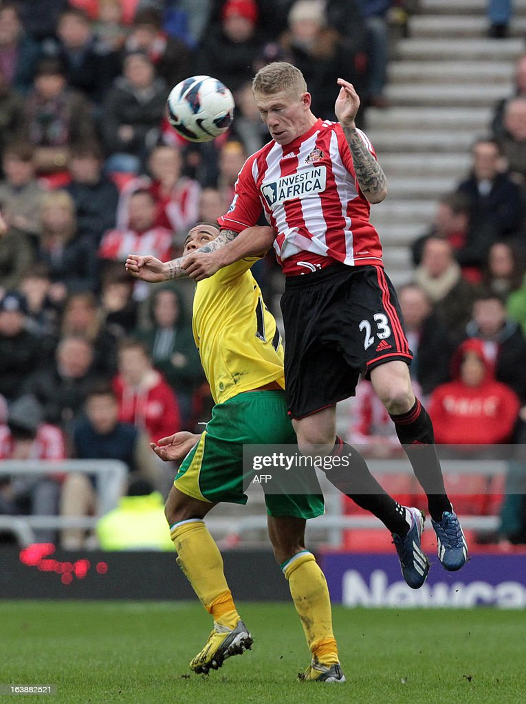 "Sunderland's James McClean (top) tackles Norwich's Elliott Bennett during the English Premier League football match between Sunderland and Norwich City at The Stadium of Light in Sunderland, north-east England, on March 17, 2013. The match ended 1-1. USE. No use with unauthorized audio, video, data, fixture lists, club/league logos or ""live"" services. Online in-match use limited to 45 images, no video emulation. No use in betting, games or single club/league/player publications."