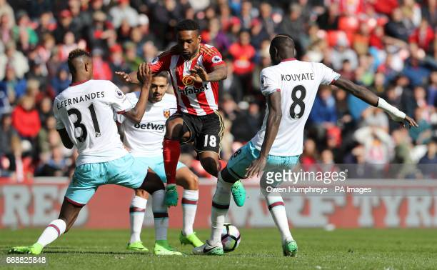 Sunderland's Jermain Defoe takes on West Ham United's Edimilson Fernandes and Cheikhou Kouyate during the Premier League match at the Stadium of...
