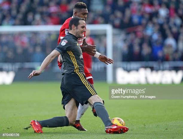 Sunderland's John O'Shea and Middlesbrough's Britt Assombalonga battle for the ball during the Sky Bet Championship match at Riverside Stadium...