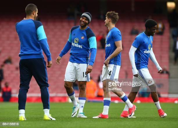Sunderland's Joleon Lescott having joke with Sunderland's Adnan Januzaj during the prematch warmup during the Premier League match between Arsenal...