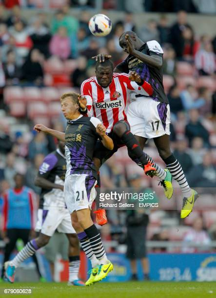 Sunderland's Jozy Altidore is challenged by Liverpool's Leiva Lucas and Mamadou Sakho during the Barclays Premier League match Sunderland v Liverpool