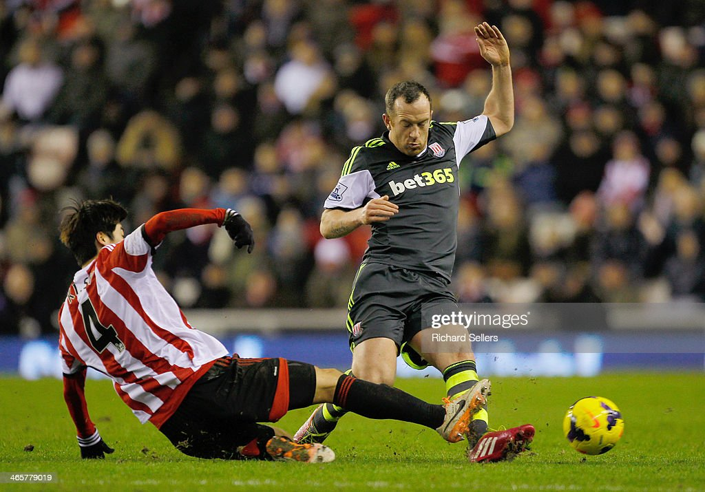 Sunderland's Ki Sung Yueng and Stoke's Charlie Adam challenge during the Barclays Premier League match between Sunderland and Stoke City at Stadium of Light on January 29, 2014 in Sunderland, England.