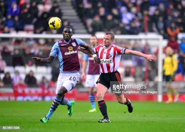 Sunderland's Lee Cattermole and Aston Villa's Christian Benteke battle for the ball