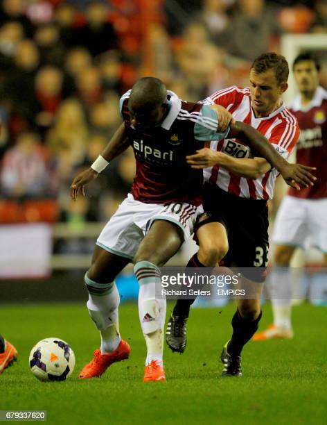 Sunderland's Lee Cattermole challenges West Ham's Guy Demel