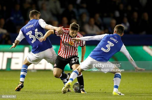 Sunderland's Lynden Gooch battles for the ball with Sheffield Wednesday's Daniel Pudil and David Jones during the Sky Bet Championship match at...