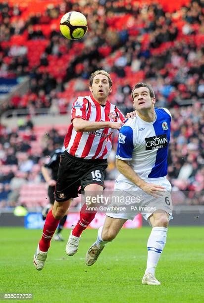 Sunderland's Michael Chopra and Blackburn Rovers' Ryan Nelsen in action