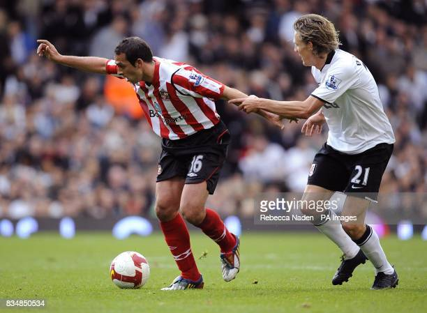Sunderland's Michael Chopra and Fulham's Jimmy Bullard battle for the ball