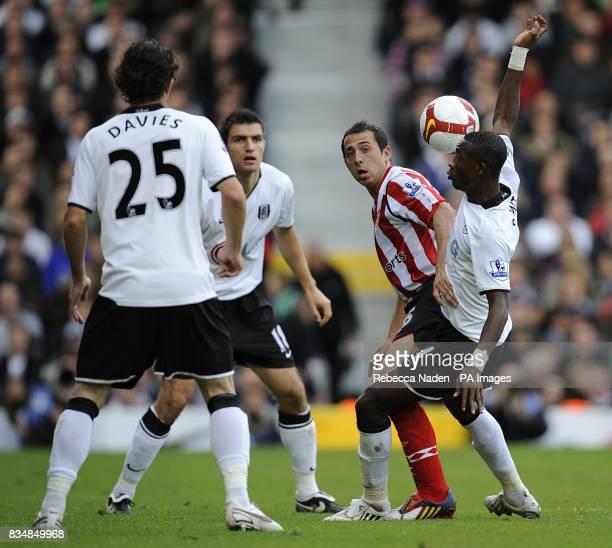 Sunderland's Michael Chopra and Fulham's John Pantsil battle for the ball