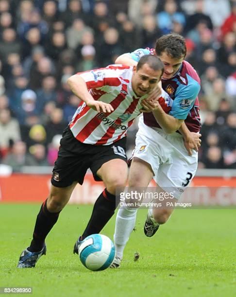 Sunderland's Michael Chopra and West Ham United's George McCartney battle for the ball