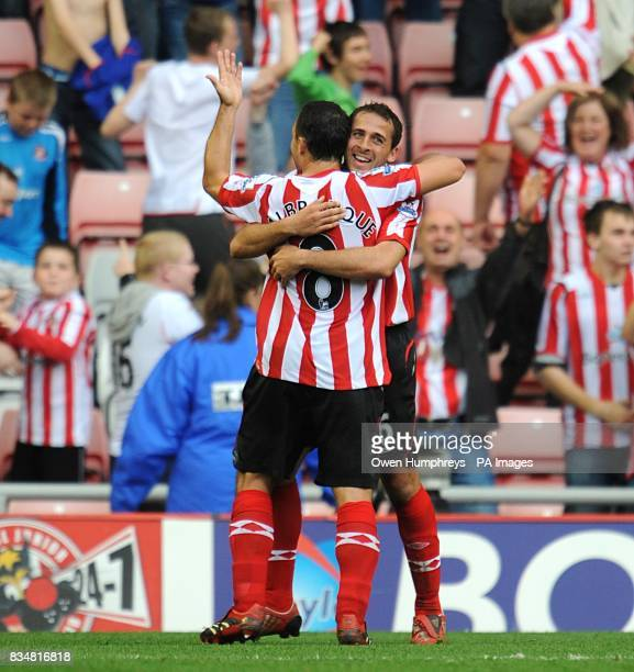 Sunderland's Michael Chopra celebrates his second goal of the game with teammate Steed Malbranque