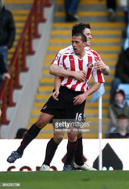 Sunderland's Michael Chopra celebrates scoring his sides first goal of the match with teammate Daryl Murphy