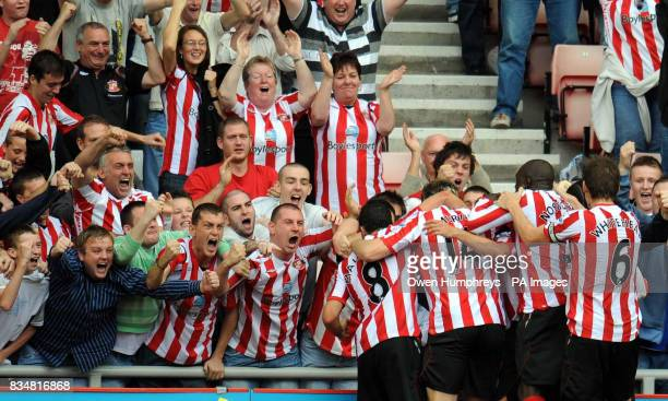 Sunderlands Michael Chopra is mobbed after scoring during the Barclays Premier League match at the Stadium of Light Sunderland