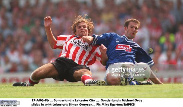 Sunderland's Michael Gray slides in with Leicester's Simon Grayson