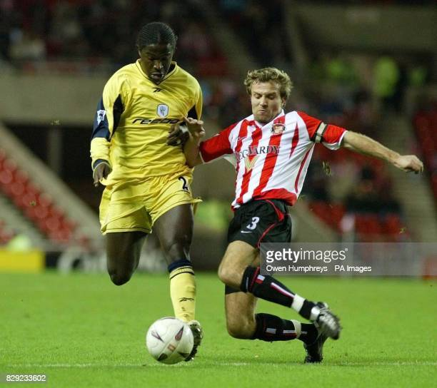 Sunderlands Michael Grays with Boltons Bernard Mendy during their FA Cup Third Round replay match the Stadium of Light Sunderland THIS PICTURE CAN...