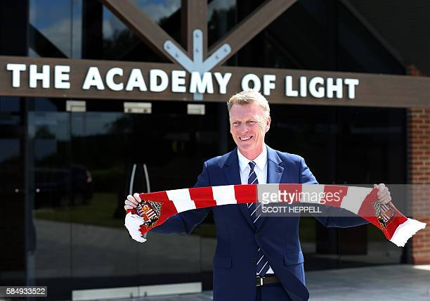 Sunderland's new Scottish manager David Moyes poses for the media with a team scarf at Sunderland AFC's Acadamy of Light in Sunderland north east...