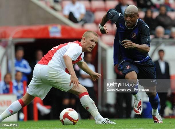 Sunderland's new signing ElHadji Diouf battles with Ajaxs Luis Suarez during the PreSeason Friendly at the Stadium Of Light Sunderland