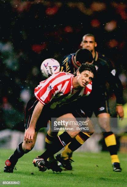 Sunderland's Niall Quinn is challenged by Southampton's Francis Benali