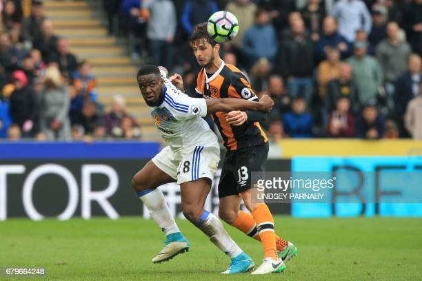 Sunderland's Nigerian striker Victor Anichebe vies with Hull City's Italian defender Andrea Ranocchia during the English Premier League football...