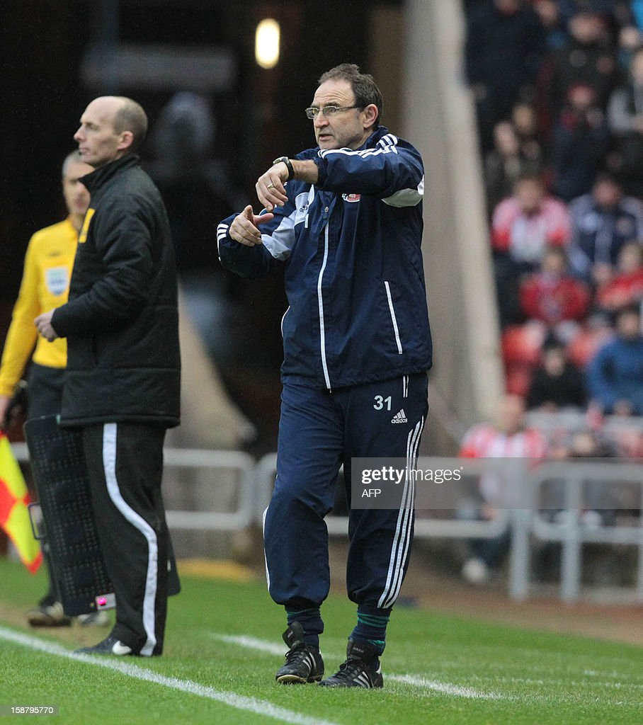 "Sunderland's Northern Irish manager Martin O'Neill appeals to the referee during the English Premier League football match between Sunderland and Tottenham Hotspur at The Stadium of Light in Sunderland, north-east England on December 29, 2012. Tottenham Hotspur won the game 2-1. USE. No use with unauthorized audio, video, data, fixture lists, club/league logos or ""live"" services. Online in-match use limited to 45 images, no video emulation. No use in betting, games or single club/league/player publications."