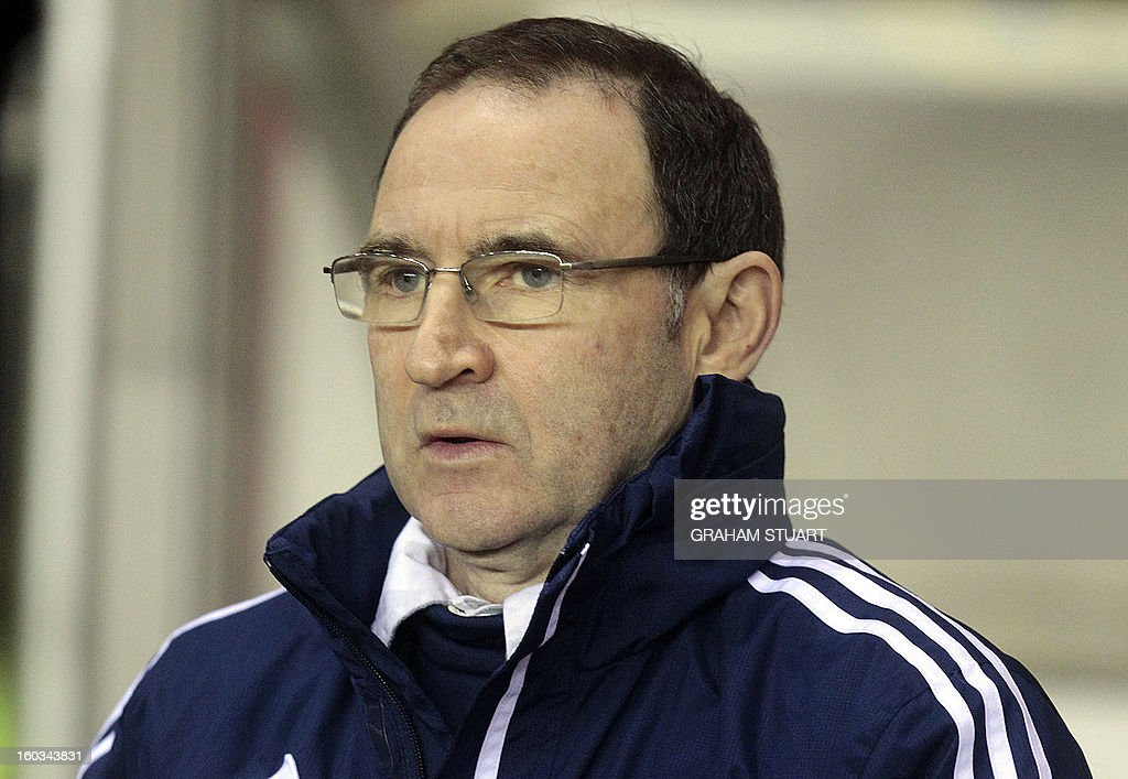"""Sunderland's Northern Irish manager Martin O'Neill looks on during the English Premier League football match between Sunderland and Swansea City at The Stadium of Light in Sunderland, north-east England on January 29, 2013. AFP PHOTO/GRAHAM STUART USE. No use with unauthorized audio, video, data, fixture lists, club/league logos or """"live"""" services. Online in-match use limited to 45 images, no video emulation. No use in betting, games or single club/league/player publications"""