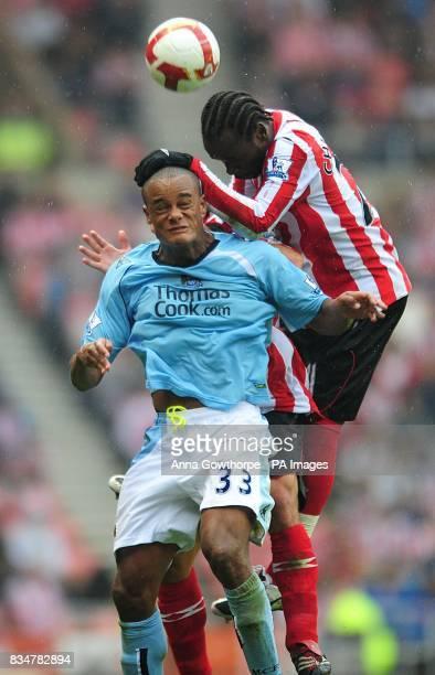 Sunderland's Pascal Chimbonda and Manchester City's Vincent Kompany battle for the ball