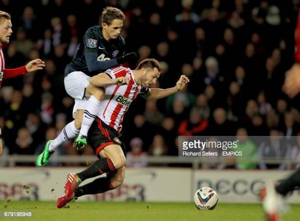 Sunderland's Phil Bardsley and Manchester United's Adnan Januzaj battle for the ball