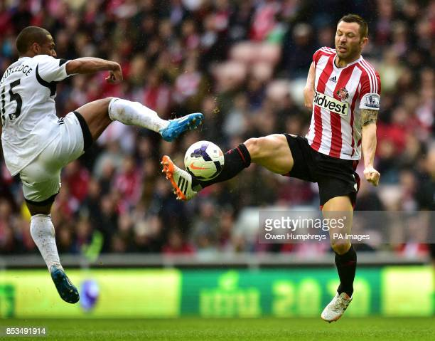 Sunderlands Phil Bardsley and Swansea's Wayne Routledge battle for the ball during the Barclays Premier League match at the Stadium of Light...
