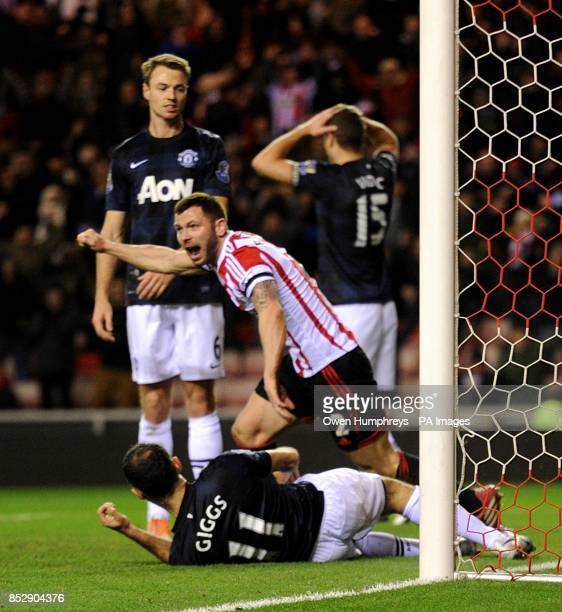 Sunderland's Phil Bardsley celebrates after Manchester United's Ryan Giggs scores and own goal