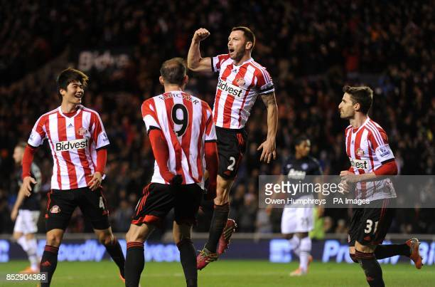 Sunderland's Phil Bardsley celebrates with his teammates after Manchester United's Ryan Giggs scores and own goal