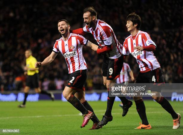 Sunderland's Phil Bardsley celebrates with teammates Steven Fletcher and SungYeung Ki after Manchester United's Ryan Giggs scores and own goal