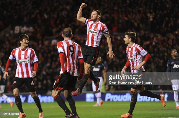 Sunderland's Phil Bardsley celebrates with teammates Steven Fletcher and SungYeung Ki after Manchester United's Ryan Giggs scores and own goal during...