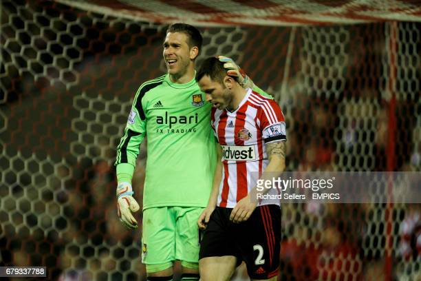 Sunderland's Phil Bardsley is consoled by West Ham's Adrian after the match