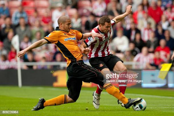 Sunderland's Phil Bardsley is tackled by Wolverhampton Wanderers' Adlene Guedioura during the Barclays Premier League match at The Stadium of Light...