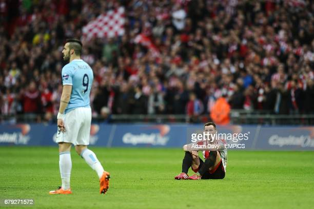 Sunderland's Phil Bardsley sits dejected on the pitch after the final whistle