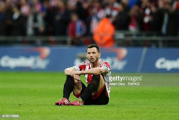 CROP* Sunderland's Phil Bardsley sits dejected on the pitch after the final whistle