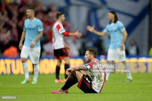 Sunderland's Phil Bardsley sits dejected on the pitch at fulltime