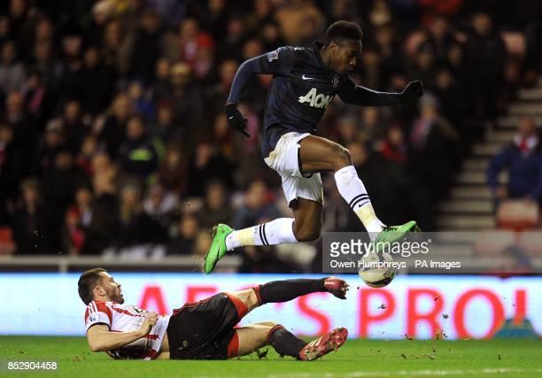 Sunderland's Phil Bardsley slides in to challenge Manchester United's Danny Welbeck