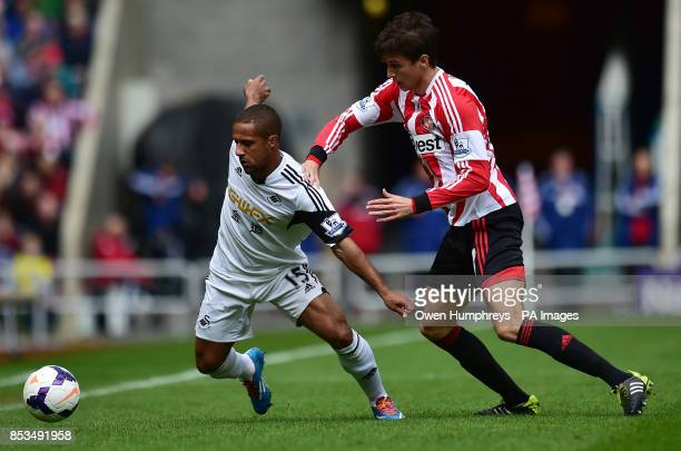 Sunderland's Santiago Vergini and Swansea's Wayne Routledge battle for the ball during the Barclays Premier League match at the Stadium of Light...