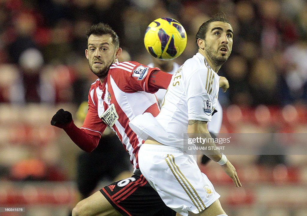 "Sunderland's Scottish striker Steven Fletcher (L) vies with Swansea City's Spanish defender Chico Flores (R) during the English Premier League football match between Sunderland and Swansea City at The Stadium of Light in Sunderland, north-east England on January 29, 2013. USE. No use with unauthorized audio, video, data, fixture lists, club/league logos or ""live"" services. Online in-match use limited to 45 images, no video emulation. No use in betting, games or single club/league/player publications"